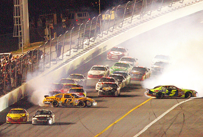 Kevin Harvick and Mark Martin race toward the finish line as a multicar crash ensues behind them.