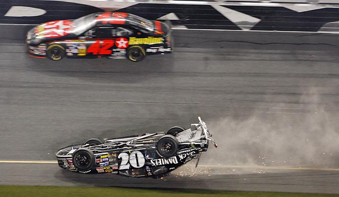 Clint Bowyer slid across the finish line with his No. 07 Chevrolet upside down and on fire after getting involved in a multi-car crash down the frontstretch.