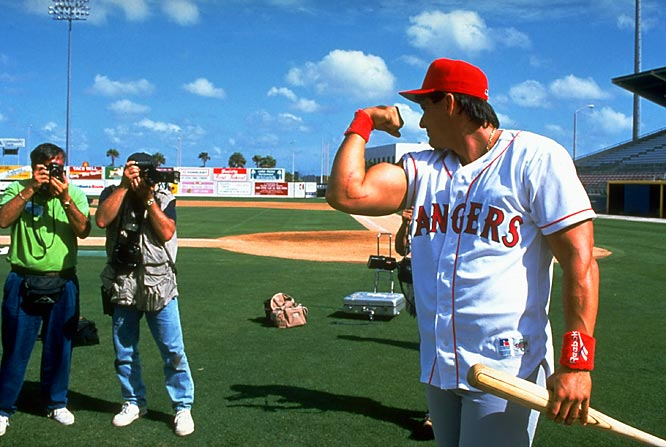 Rangers slugger Jose Canseco showed off the scar from the elbow injury he suffered during his ill-advised pitching foray the previous season.