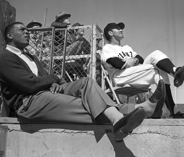 Willie Mays and Al Dark watch a game during the Giants spring training in Phoenix.