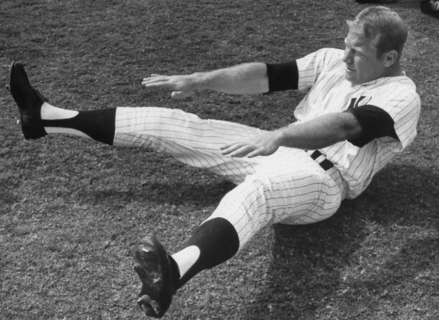 Mickey Mantle stretches before a workout.