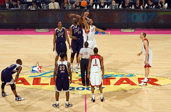Shaquille O'Neal and Tim Duncan compete for the opening tip-off at the 2007 NBA All-Star Game.