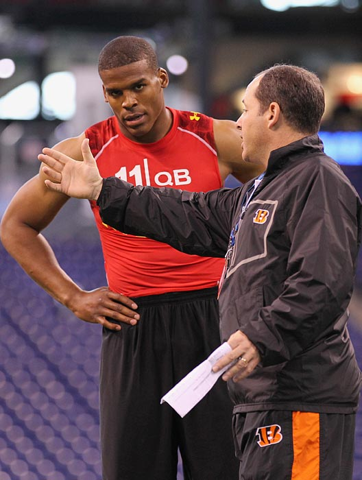 "After a Heisman Trophy year filled with controversy, the intrigue followed Newton to the 2011 combine. Newton got flustered and defensive when an NFL team asked him why he ignored Gene Chizik's call to take a knee and instead ran a quarterback sneak in the BCS National Championship Game. He also had to defend himself for a comment in which he described himself ""not only as a football player, but an entertainer and icon."" The questions his attitude and comments raised were quickly answered in the NFL as Newton won the 2011 Offensive Rookie of the Year and earned a Pro Bowl nod."