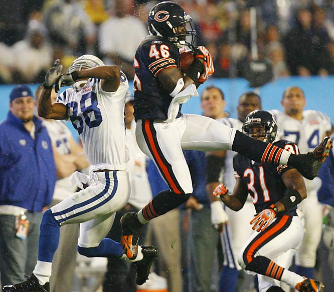 Chris Harris intercepts a pass intended for Marvin Harrison on the Colts' opening drive.