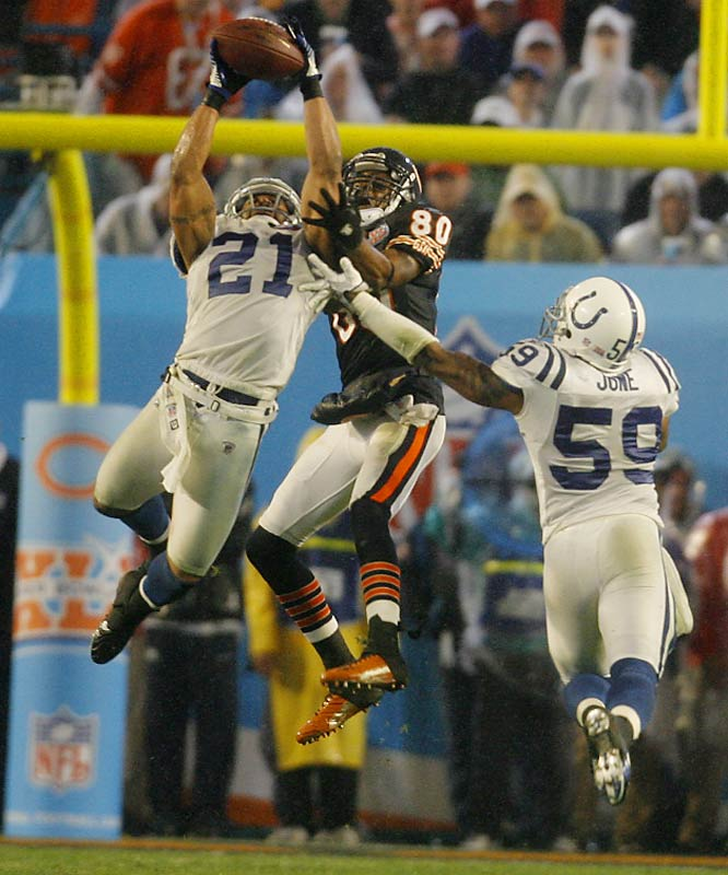 Bob Sanders reached high for this interception against Bernard Berrian.