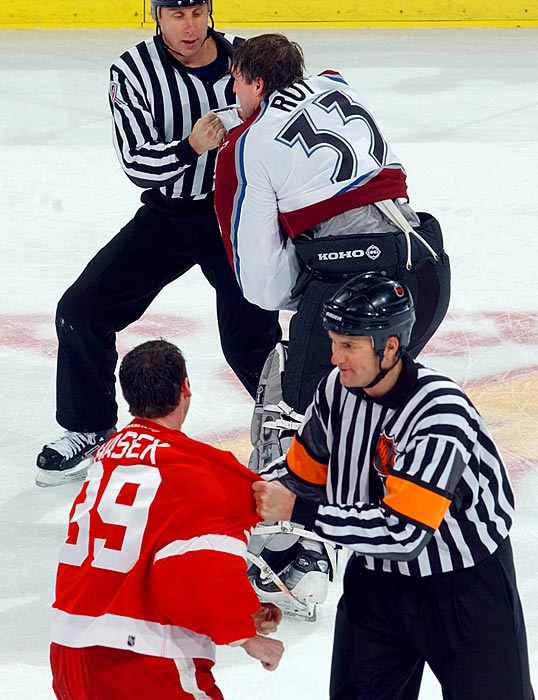 When the prickly Roy got into a tussle in his own net with Detroit's Kirk Maltby, the crease quickly became more crowded  than the state room  in the old Marx Brothers movie. Then Hasek came steaming in -- on his caboose -- taking out Roy like a bowling pin. A slapstick classic.  Click here to watch the fight!