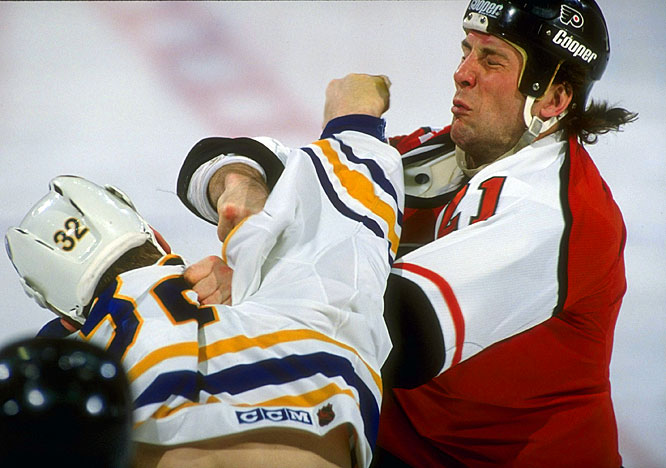 A classic Flyers bully, Brown roamed the ice for Philly, through the 1980s and again in the 90s after a stop in Edmonton, making life very unpleasant for anyone who took liberties with his teammates. A ferocious puncher, the 6-5, 220-pound winger was so feared that sometimes only a glance, a word or a tap on the shoulder from him would be enough to send a foe scurrying for safety.