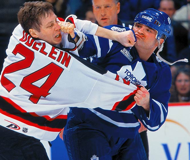 "A fan favorite in Toronto, New York and Winnipeg, the relatively diminutive Domi (5' 10"", 213) battled all comers. Inspired by his childhood hero Tiger Williams, Tie racked up 1.020 PIM (third all-time) and ably rode shotgun for Maple Leaf stars Doug Gilmour and Mats Sundin."