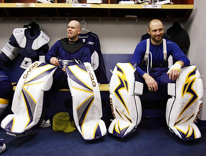 Friday 10:45AM<br> Goalies Chris Mason and Tomas Vokoun get dressed for practice.