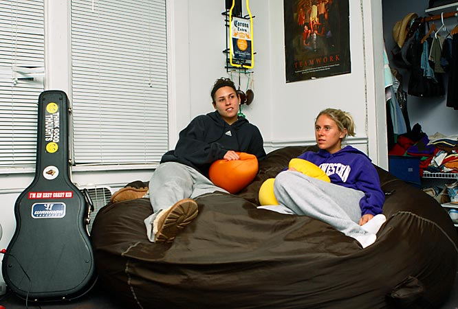 Lindsay Finocchiaro's (left) room is the biggest in the house, with the most attractive asset by far being the giant beanbag chair. The New Jersey native (seen here with Kristen Kjellman) also strums the guitar in between practice, school and singing karaoke.