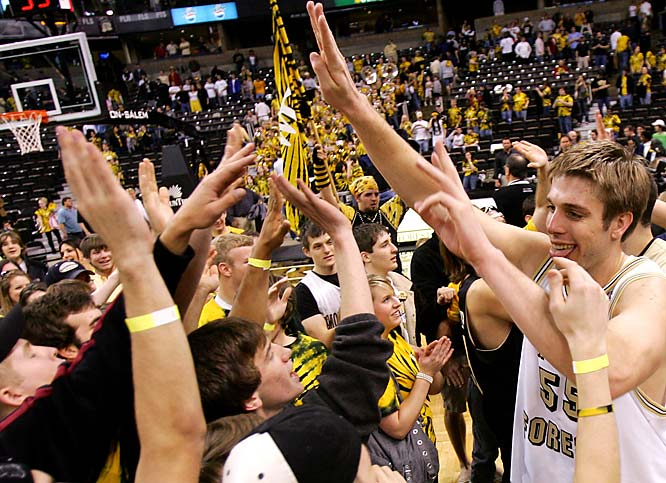 Wake Forest's Kyle Visser celebrates with fans after the Demon Deacons defeated Virginia, 78-72, in Winston Salem.