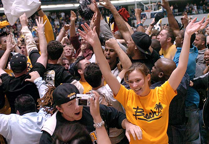 Long Beach State fans celebrate after the 49ers' 94-83 victory over Cal-Poly in the championship  of the Big West men's basketball tournament on Saturday.