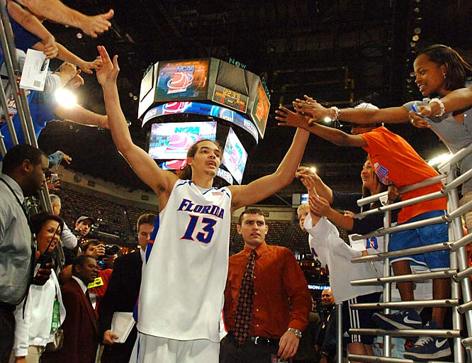Joakim Noah slaps hands with fans as he leaves the court after Florida beat Purdue to advance to the Sweet 16.