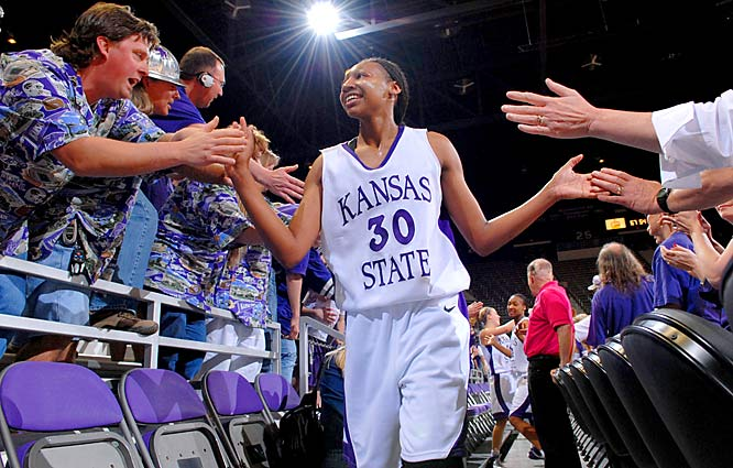 Kansas State's Shana Wheeler celebrates with fans after beating Auburn in the Elite Eight of the WNIT 67-54 in Manhattan, Kansas.