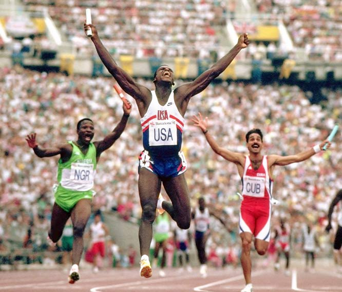 "Frakes' take: <br><br>""Aug. 9, 1992, at the Barcelona Olympics, was perhaps the greatest day ever for track and field. This is the finish of the 4 x 100 relay. All three winning teams ran under the existing world record. The U.S. team anchored by Carl Lewis (celebrating here) won gold.""<br><br> Shot with Canon EOS 1"