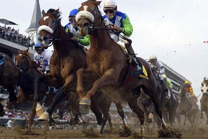 "Frakes' take:<br><br> ""I use remotes cameras to give our readers a perspective that they can't get otherwise.  This is a shot of eventual Kentucky Derby winner Barbaro as the pack surges past Churchill Downs Twin Spires the first time around. It's taken from a camera buried in the dirt under the rail.""<br><br> Shot with Canon EOS 1D"