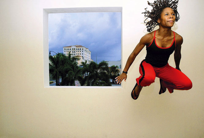 "Frakes' take: <br><br>""Lauryn Williams, the 100m track world champion, stretches her legs. I asked her to hop up to the ledge, and she did. Two frames later we were finished. It's great working with people who have tremendous skills.""<br><br> Shot with Canon 1Ds"