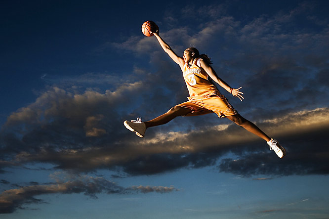 "Frakes' take: <br><br> ""To show the elegance, power and athleticism of Tennessee's Candace Parker, I had her jump against the sunset while I used strobes to illuminate her. She has a complete game but watching her take flight and dunk is the best.""<br><br> Shot with Canon Mark IIDs"