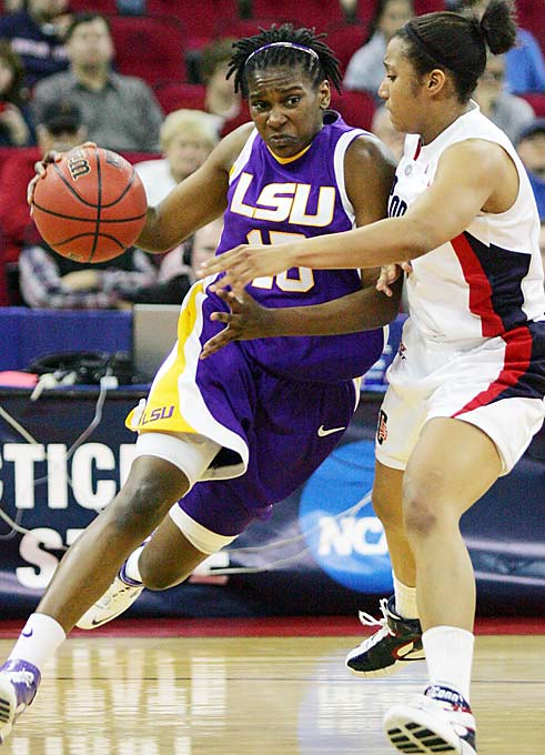 LSU's Quinna Chaney drives past Connecticut's Ketia Swanier in the second half of the Elite Eight game. The 23-point defeat was the most lopsided loss suffered by UConn in 15 years.