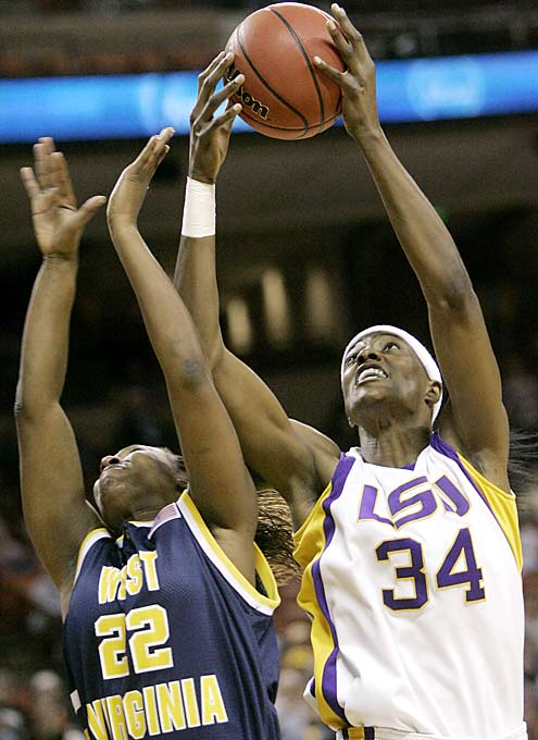 LSU center Sylvia Fowles powers over West Virginia's Chakhia Cole. Fowles had 21 points to help the Lady Tigers rally from 11 points down in the game's final 12 minutes.
