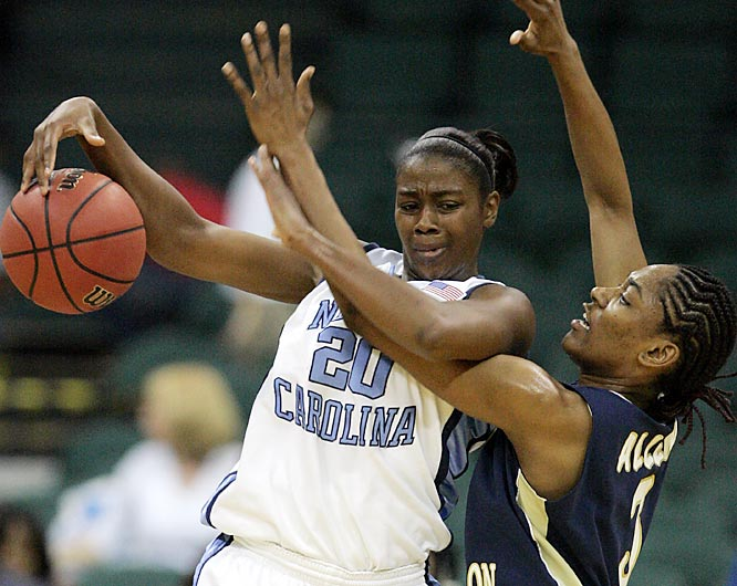 Tar Heels forward Camille Little protects the ball against George Washington's Whitney Allen.