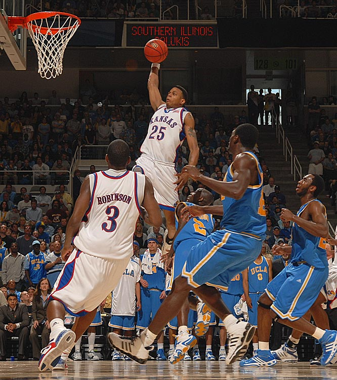 Kansas guard Brandon Rush, who finished with a team-high xx points, soars for a dunk in the Jayhawks' loss.