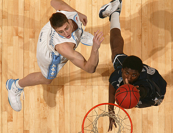 UNC's Tyler Hansbrough and Georgetown's Roy Hibbert fight for the ball underneath the basket.