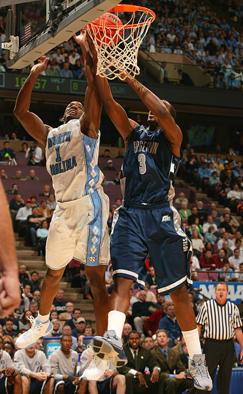 North Carolina's Marcus Ginyard and Georgetown's DaJuan Summers fight for a rebound in the first half Sunday.