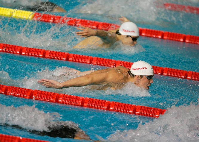 Michael Phelps ensures he does enough to qualify in a Mens 200M Individual Medley heat.