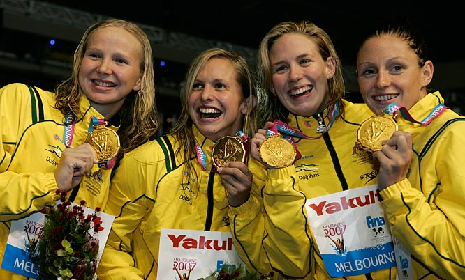 Gold medalists Melanie Schlanger, Shayne Reese, Libby Lenton and Jodie Henry of Australia display their medals following the 4x100 freestyle relay.