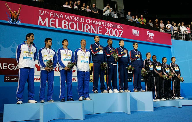 The U.S. 4x100m relay team of Neil Walker, Cullen Jones, Michael Phelps and Jason Lezak during the medal presentation. Italy took silver and France bronze.