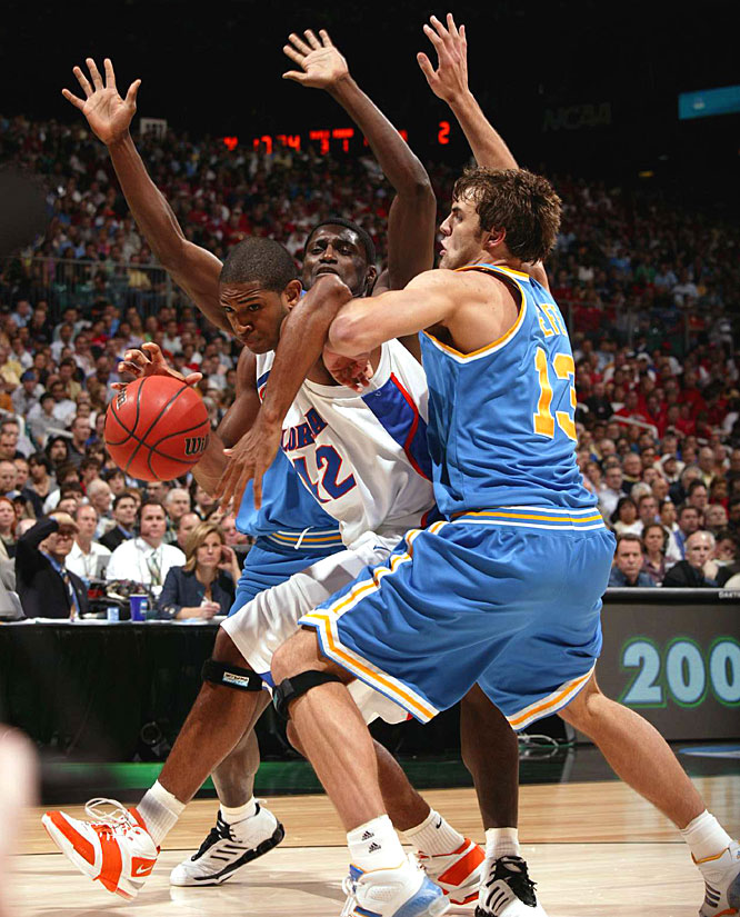 Al Horford, who chipped in nine points for the Gators, fights off two UCLA defenders.