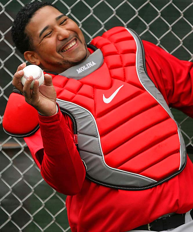 Jose Molina jokes with teammates during a workout.