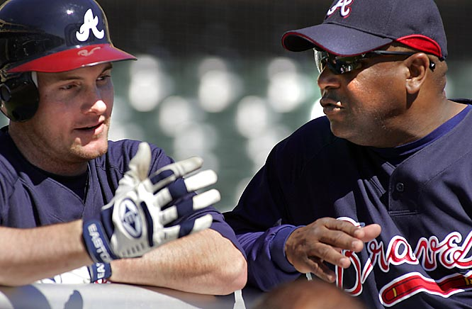 Outfielder Ryan Lagerhans, left, talks with hitting coach and former NL MVP Terry Pendleton.