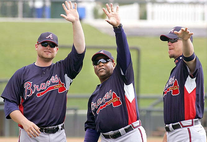 Brian McCann, left, Terry Pendleton, center, and infielder Chipper Jones do the wave.