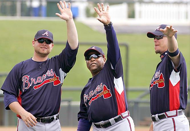 Brian McCann, left, Terry Pendleton, center, and infielder Chipper Jones do the wave.