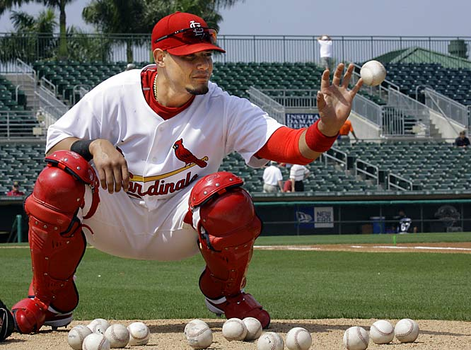 Catcher Yadier Molina warms up without his glove before a game against the Marlins.