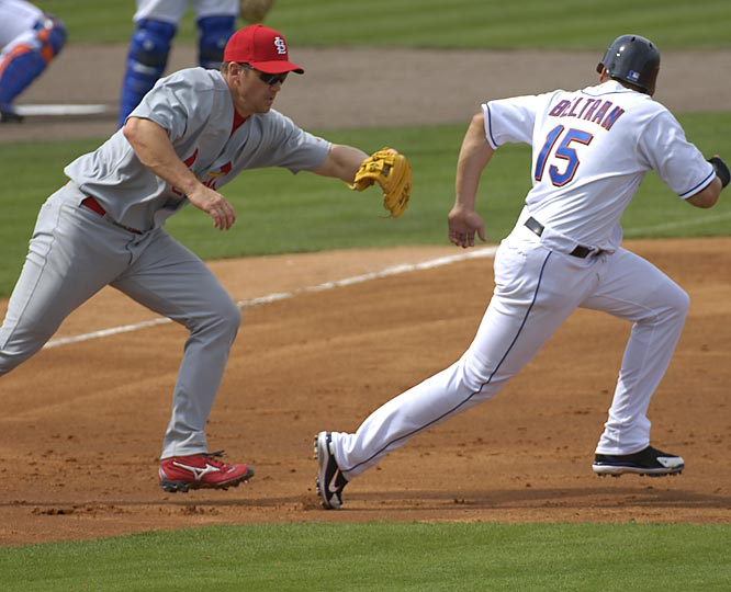 Scott Rolen tags out the Mets' Carlos Beltran during a game at Port St. Lucie, Fla.