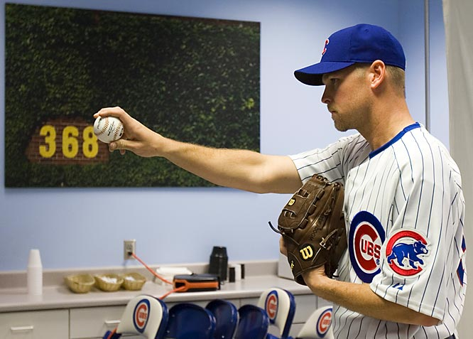 With a picture of the Wrigley Field ivy on the background, Chicago Cubs pitcher Kerry Wood poses for a picture. His spring got off to an inauspicious start as he was injured getting out of a hot tub.