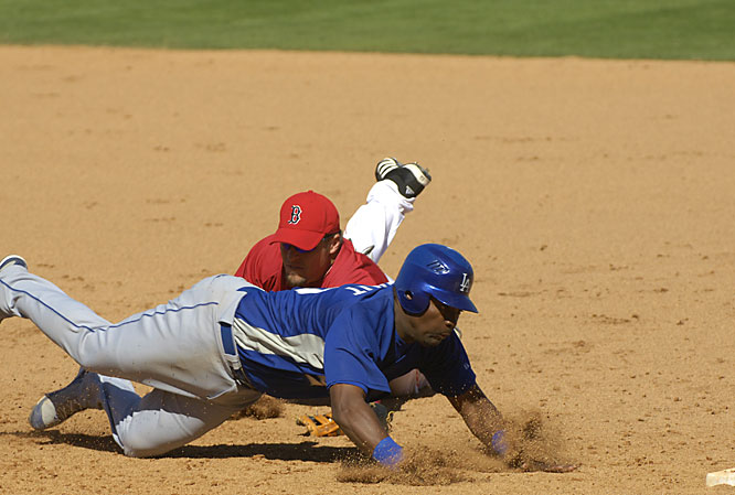 Wilson Betemit beats the tag at first by Eric Hinske.