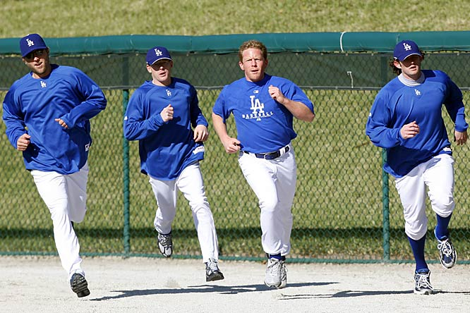 (Left to right) Brett Tomko, Chad Billingsley, Randy Wolf and Tim Hamulack run laps during pitcher workouts.