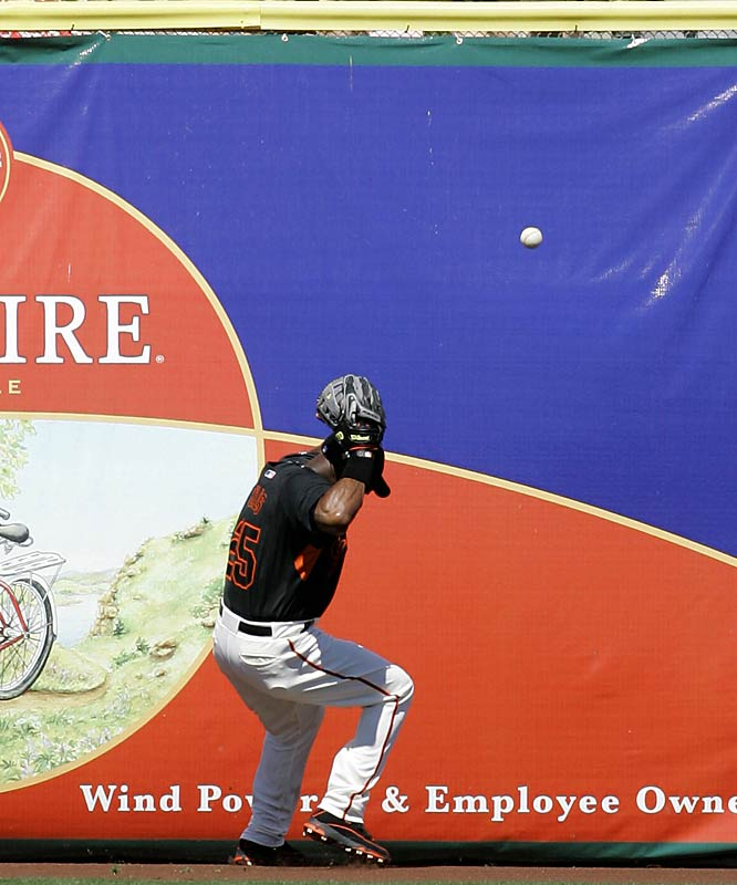 Duck! Bonds fails to catch this fly ball off the bat of the Cubs' Ryan Theriot on March 12.