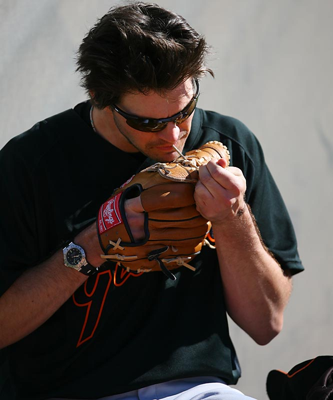 Zito tightens up the laces on his glove.