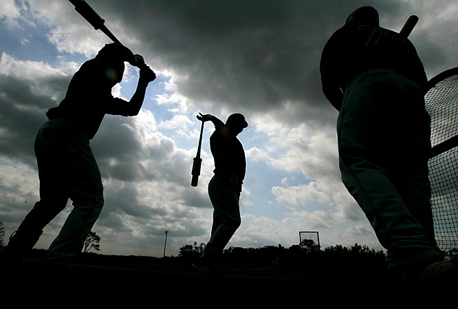 Shadow dancing: (Left to right) Franklin Gutierrez, Ryan Garko and Wyatt Toregas prepare to take batting practice.