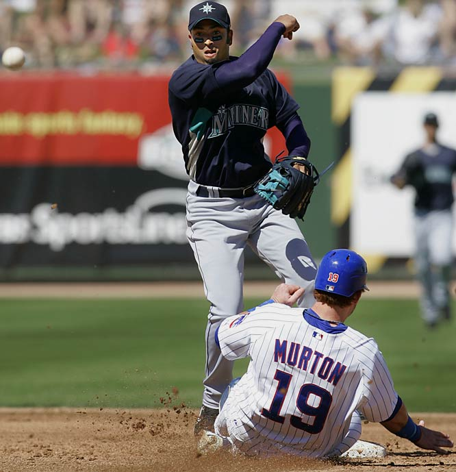 Michael Garciaparra, Nomar's younger brother, turns a double play in a game against the Cubs on March 15.