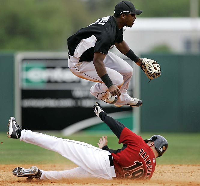 Ramirez hops over Houston's Orlando Palmeiro to complete a double play.