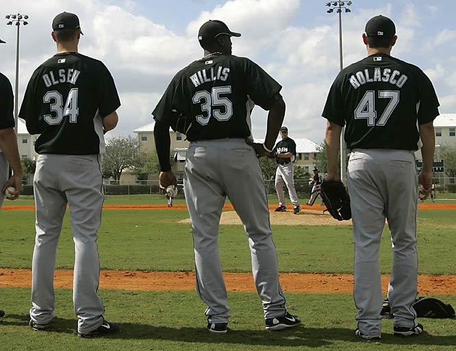 Young guns: Pitchers Scott Olsen (34), Dontrelle Willis (35) and Ricky Nolasco (47) look on during pitching practice.