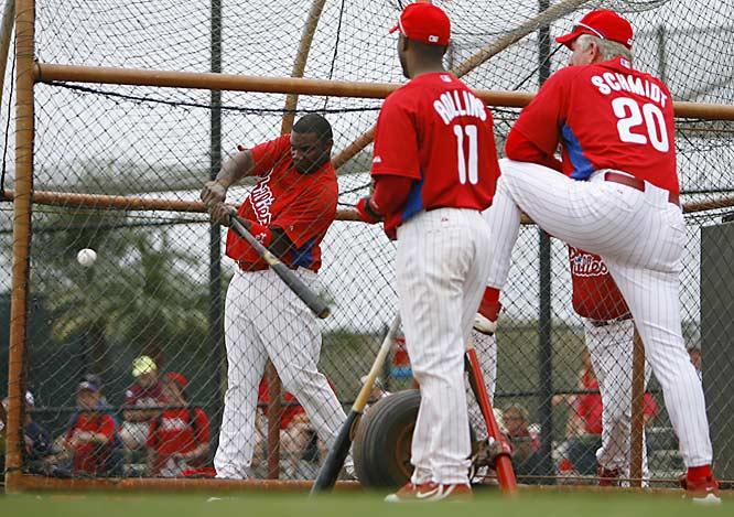 Schmidt and Jimmy Rollins watch Howard take batting practice.