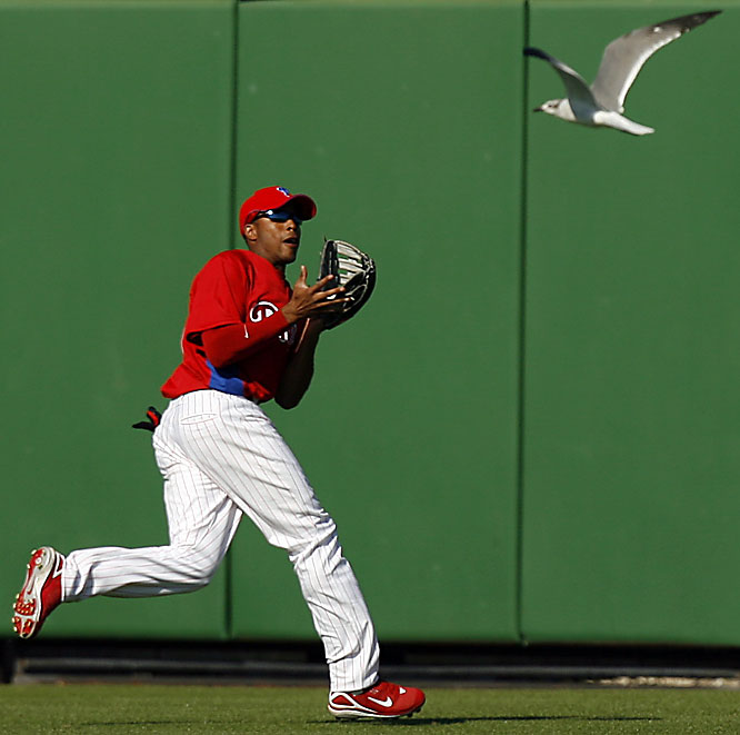 Centerfielder Chris Roberson calls off the seagull coming from right field for a fly ball.