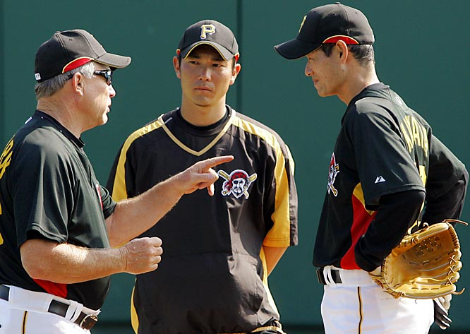Pitcher Masumi Kuwata, right, from Japan, gets instruction from pitching coach Jim Colborn.